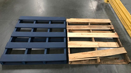 Picture showing two pallets, one coated with Resam PPS